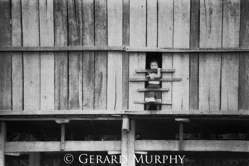 Child at Window, Jinghong, Yunan